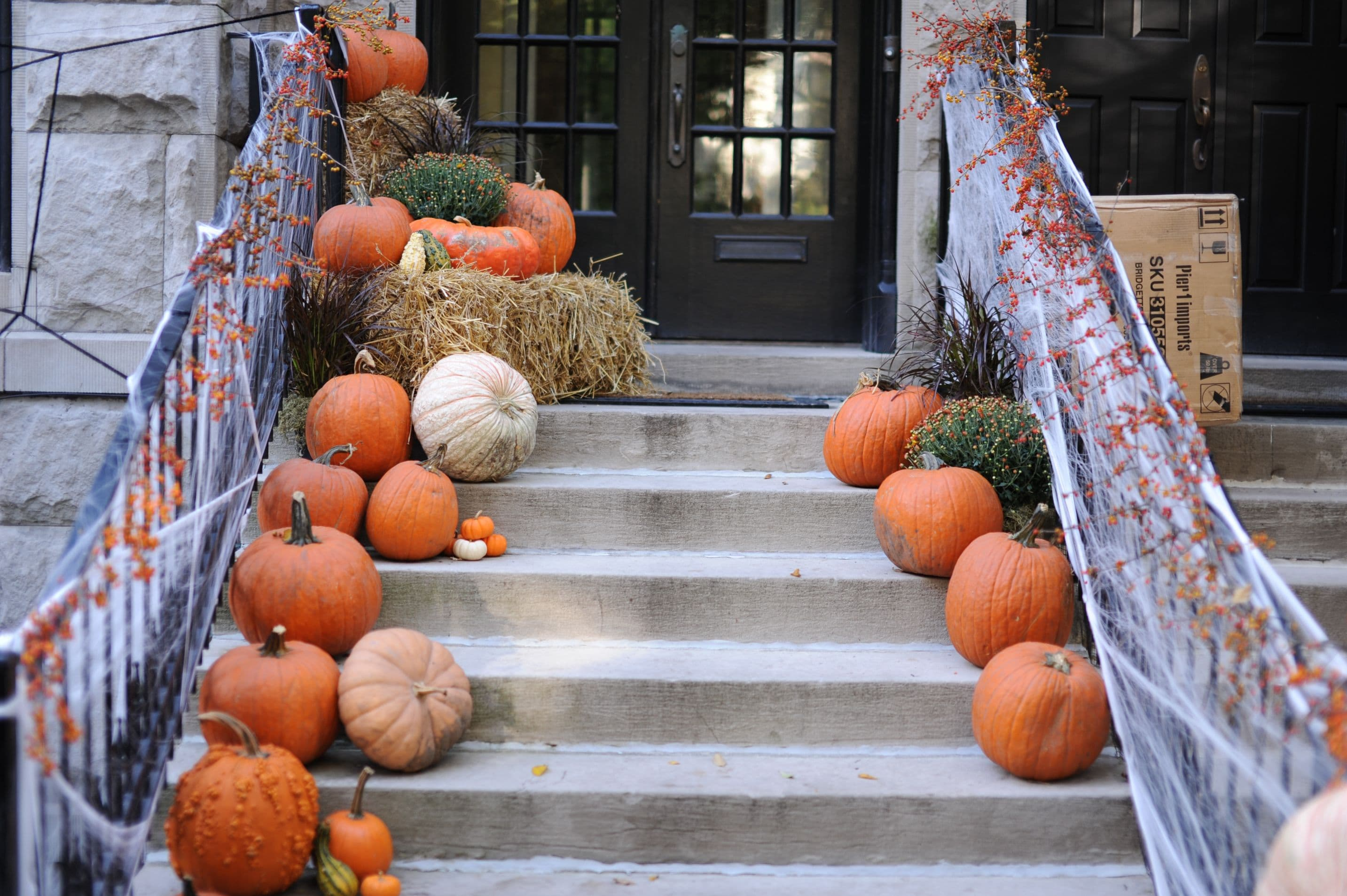 Putting Up Front Porch Fall Decor